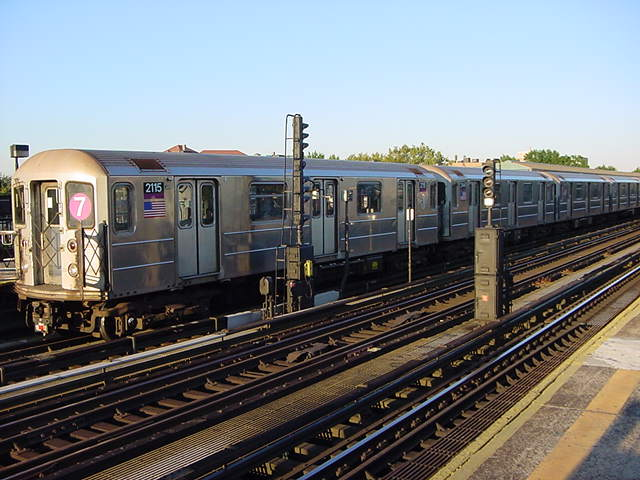 (60k, 640x480)<br><b>Country:</b> United States<br><b>City:</b> New York<br><b>System:</b> New York City Transit<br><b>Line:</b> IRT Flushing Line<br><b>Location:</b> 69th Street/Fisk Avenue <br><b>Route:</b> 7<br><b>Car:</b> R-62A (Bombardier, 1984-1987)  2115 <br><b>Photo by:</b> Salaam Allah<br><b>Date:</b> 9/17/2002<br><b>Viewed (this week/total):</b> 1 / 1981