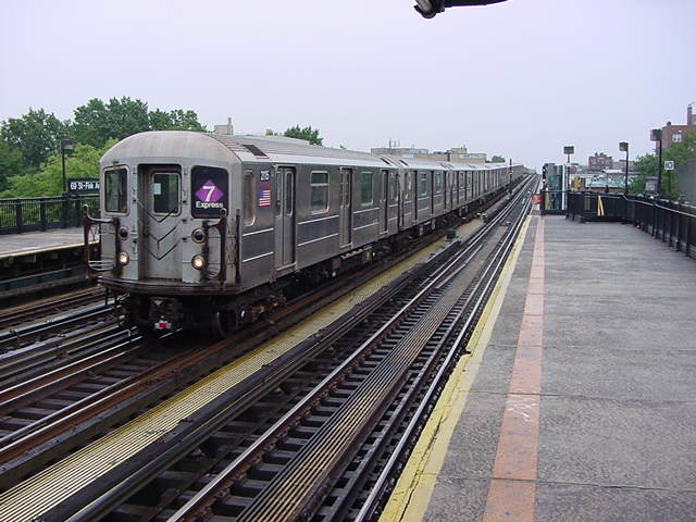 (60k, 640x480)<br><b>Country:</b> United States<br><b>City:</b> New York<br><b>System:</b> New York City Transit<br><b>Line:</b> IRT Flushing Line<br><b>Location:</b> 69th Street/Fisk Avenue <br><b>Route:</b> 7<br><b>Car:</b> R-62A (Bombardier, 1984-1987)  2115 <br><b>Photo by:</b> Salaam Allah<br><b>Date:</b> 9/26/2002<br><b>Viewed (this week/total):</b> 2 / 2423