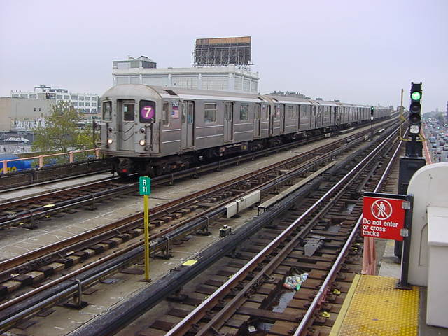 (60k, 640x480)<br><b>Country:</b> United States<br><b>City:</b> New York<br><b>System:</b> New York City Transit<br><b>Line:</b> IRT Flushing Line<br><b>Location:</b> 33rd Street/Rawson Street <br><b>Route:</b> 7<br><b>Car:</b> R-62A (Bombardier, 1984-1987)  2142 <br><b>Photo by:</b> Salaam Allah<br><b>Date:</b> 9/27/2002<br><b>Viewed (this week/total):</b> 2 / 2674