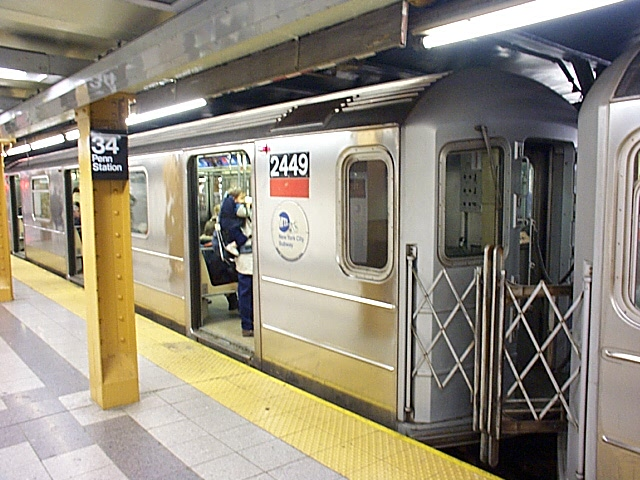 (132k, 640x480)<br><b>Country:</b> United States<br><b>City:</b> New York<br><b>System:</b> New York City Transit<br><b>Line:</b> IRT West Side Line<br><b>Location:</b> 34th Street/Penn Station <br><b>Route:</b> 1<br><b>Car:</b> R-62A (Bombardier, 1984-1987)  2449 <br><b>Photo by:</b> Richard Brome<br><b>Date:</b> 3/19/1999<br><b>Viewed (this week/total):</b> 6 / 5439