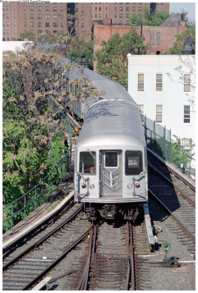 (343k, 790x1167)<br><b>Country:</b> United States<br><b>City:</b> New York<br><b>System:</b> New York City Transit<br><b>Location:</b> East New York Yard/Shops<br><b>Car:</b> R-42 (St. Louis, 1969-1970)   <br><b>Photo by:</b> David Pirmann<br><b>Date:</b> 10/11/1996<br><b>Notes:</b> Train exiting East New York yard onto Broadway Elevated<br><b>Viewed (this week/total):</b> 1 / 5359