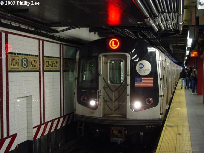 (63k, 799x600)<br><b>Country:</b> United States<br><b>City:</b> New York<br><b>System:</b> New York City Transit<br><b>Line:</b> BMT Canarsie Line<br><b>Location:</b> 8th Avenue <br><b>Route:</b> L<br><b>Car:</b> R-143 (Kawasaki, 2001-2002)  <br><b>Photo by:</b> Phillip Lee<br><b>Date:</b> 12/28/2003<br><b>Viewed (this week/total):</b> 0 / 1927