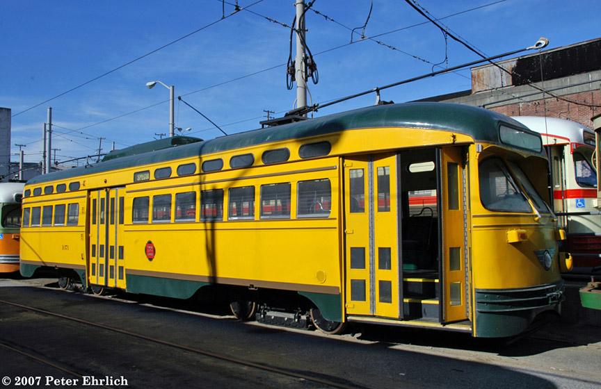 (200k, 864x560)<br><b>Country:</b> United States<br><b>City:</b> San Francisco/Bay Area, CA<br><b>System:</b> SF MUNI<br><b>Location:</b> Geneva Yard <br><b>Car:</b> SF MUNI PCC (Ex-NJTransit, Ex-Twin City) (St. Louis Car Co., 1946-1947)  1071 <br><b>Photo by:</b> Peter Ehrlich<br><b>Date:</b> 3/12/2007<br><b>Notes:</b> At Geneva Yard, after delivery.<br><b>Viewed (this week/total):</b> 3 / 1988