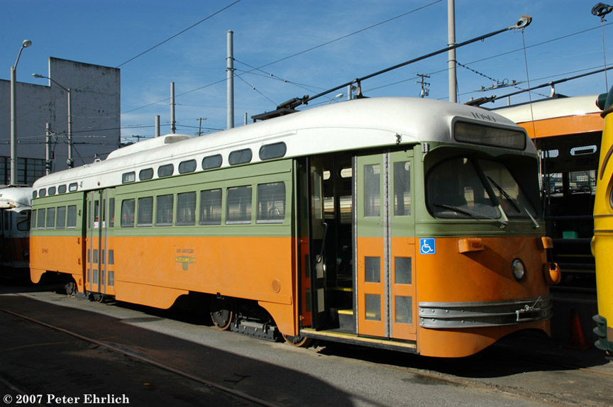 (176k, 864x574)<br><b>Country:</b> United States<br><b>City:</b> San Francisco/Bay Area, CA<br><b>System:</b> SF MUNI<br><b>Location:</b> Geneva Yard <br><b>Car:</b> SF MUNI PCC (Ex-NJTransit, Ex-Twin City) (St. Louis Car Co., 1946-1947)  1080 <br><b>Photo by:</b> Peter Ehrlich<br><b>Date:</b> 3/12/2007<br><b>Notes:</b> Geneva Yard, two days after delivery.<br><b>Viewed (this week/total):</b> 1 / 587