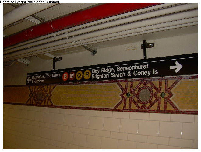 (101k, 660x500)<br><b>Country:</b> United States<br><b>City:</b> New York<br><b>System:</b> New York City Transit<br><b>Location:</b> DeKalb Avenue<br><b>Photo by:</b> Zach Summer<br><b>Date:</b> 8/13/2006<br><b>Notes:</b> Restored mosaic band tile at DeKalb Ave.<br><b>Viewed (this week/total):</b> 1 / 2364