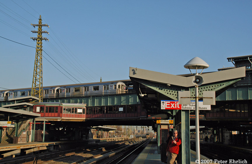 (170k, 864x563)<br><b>Country:</b> United States<br><b>City:</b> New York<br><b>System:</b> New York City Transit<br><b>Line:</b> IRT Flushing Line<br><b>Location:</b> 61st Street/Woodside <br><b>Car:</b> R-62A (Bombardier, 1984-1987)  1980 <br><b>Photo by:</b> Peter Ehrlich<br><b>Date:</b> 4/11/2007<br><b>Notes:</b> Outbound train at 61st/Woodside Station, viewed from LIRR platform.<br><b>Viewed (this week/total):</b> 0 / 1424