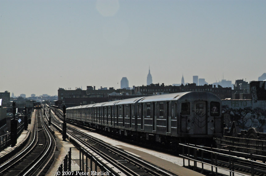 (147k, 864x574)<br><b>Country:</b> United States<br><b>City:</b> New York<br><b>System:</b> New York City Transit<br><b>Line:</b> IRT Flushing Line<br><b>Location:</b> Junction Boulevard <br><b>Car:</b> R-62A (Bombardier, 1984-1987)  2091 <br><b>Photo by:</b> Peter Ehrlich<br><b>Date:</b> 4/20/2007<br><b>Notes:</b> Inbound train leaving Junction Blvd., trailing view.<br><b>Viewed (this week/total):</b> 5 / 1969