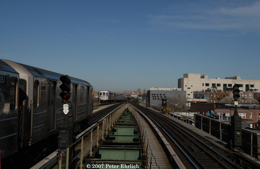 (152k, 864x561)<br><b>Country:</b> United States<br><b>City:</b> New York<br><b>System:</b> New York City Transit<br><b>Line:</b> IRT Flushing Line<br><b>Location:</b> Junction Boulevard <br><b>Car:</b> R-62A (Bombardier, 1984-1987)  2154 <br><b>Photo by:</b> Peter Ehrlich<br><b>Date:</b> 4/20/2007<br><b>Notes:</b> Outbound train leaving Junction Blvd. with an inbound train on left.<br><b>Viewed (this week/total):</b> 1 / 1221