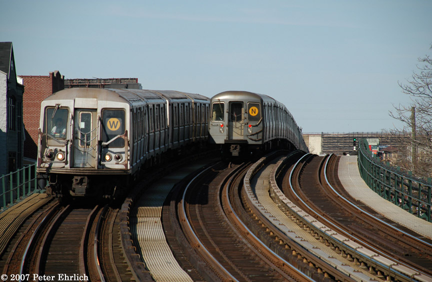 (182k, 864x565)<br><b>Country:</b> United States<br><b>City:</b> New York<br><b>System:</b> New York City Transit<br><b>Line:</b> BMT Astoria Line<br><b>Location:</b> 30th/Grand Aves. <br><b>Car:</b> R-40 (St. Louis, 1968)  4157 <br><b>Photo by:</b> Peter Ehrlich<br><b>Date:</b> 4/20/2007<br><b>Notes:</b> Inbound train passing a layup train, approaching 30th Avenue/Grand Station.<br><b>Viewed (this week/total):</b> 1 / 2825