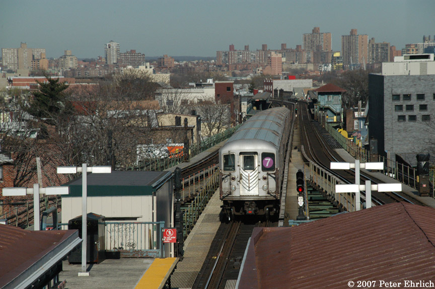 (209k, 864x574)<br><b>Country:</b> United States<br><b>City:</b> New York<br><b>System:</b> New York City Transit<br><b>Line:</b> IRT Flushing Line<br><b>Location:</b> Junction Boulevard <br><b>Car:</b> R-62A (Bombardier, 1984-1987)   <br><b>Photo by:</b> Peter Ehrlich<br><b>Date:</b> 4/20/2007<br><b>Notes:</b> Outbound train leaving Junction Blvd., trailing view.<br><b>Viewed (this week/total):</b> 0 / 2022