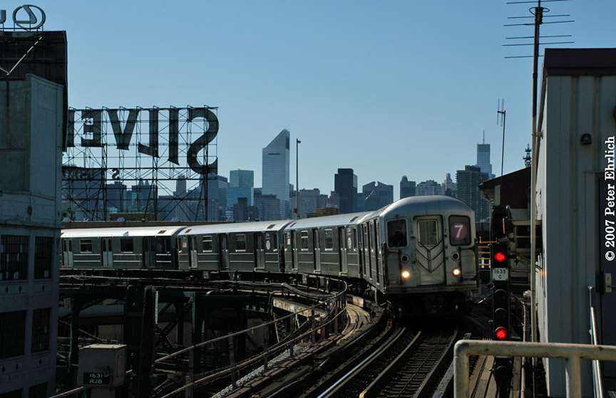 (168k, 864x559)<br><b>Country:</b> United States<br><b>City:</b> New York<br><b>System:</b> New York City Transit<br><b>Line:</b> IRT Flushing Line<br><b>Location:</b> Queensborough Plaza <br><b>Car:</b> R-62A (Bombardier, 1984-1987)   <br><b>Photo by:</b> Peter Ehrlich<br><b>Date:</b> 4/20/2007<br><b>Notes:</b> Outbound local approaching Queensboro Plaza.<br><b>Viewed (this week/total):</b> 3 / 1383