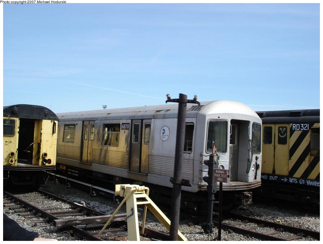 (144k, 1044x788)<br><b>Country:</b> United States<br><b>City:</b> New York<br><b>System:</b> New York City Transit<br><b>Location:</b> Coney Island Yard<br><b>Car:</b> R-42 (St. Louis, 1969-1970)  4878 <br><b>Photo by:</b> Michael Hodurski<br><b>Date:</b> 4/14/2007<br><b>Notes:</b> Being scrapped along with R14 RD321 on right.<br><b>Viewed (this week/total):</b> 4 / 1235