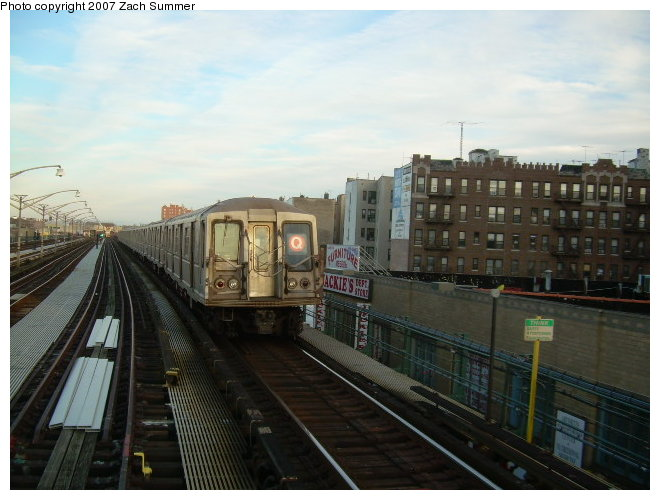 (108k, 660x500)<br><b>Country:</b> United States<br><b>City:</b> New York<br><b>System:</b> New York City Transit<br><b>Line:</b> BMT Brighton Line<br><b>Location:</b> Ocean Parkway <br><b>Route:</b> Q<br><b>Car:</b> R-40 (St. Louis, 1968)   <br><b>Photo by:</b> Zach Summer<br><b>Date:</b> 12/3/2006<br><b>Notes:</b> Incorrect orange Q.<br><b>Viewed (this week/total):</b> 1 / 2127