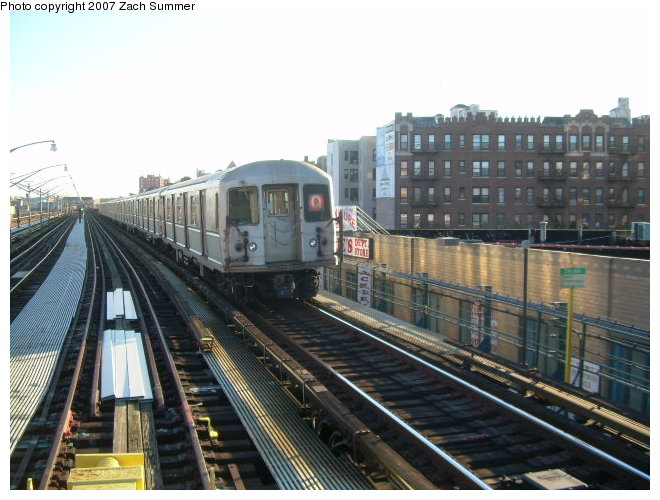 (120k, 660x500)<br><b>Country:</b> United States<br><b>City:</b> New York<br><b>System:</b> New York City Transit<br><b>Line:</b> BMT Brighton Line<br><b>Location:</b> Ocean Parkway <br><b>Route:</b> Q<br><b>Car:</b> R-40M (St. Louis, 1969)   <br><b>Photo by:</b> Zach Summer<br><b>Date:</b> 12/16/2006<br><b>Notes:</b> Incorrect orange Q.<br><b>Viewed (this week/total):</b> 3 / 1647