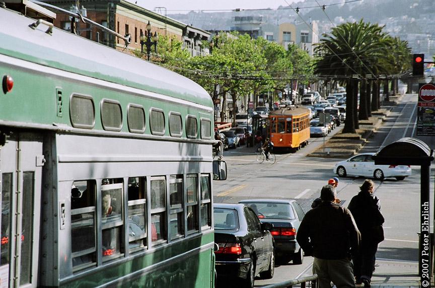 (237k, 864x573)<br><b>Country:</b> United States<br><b>City:</b> San Francisco/Bay Area, CA<br><b>System:</b> SF MUNI<br><b>Location:</b> Market/Church/14th <br><b>Car:</b> SF MUNI PCC (Ex-SEPTA) (St. Louis Car Co., 1947-1948)  1053 <br><b>Photo by:</b> Peter Ehrlich<br><b>Date:</b> 5/16/2007<br><b>Notes:</b> Market/Church.  1053 outbound, trailing view, with Milan 1815 inbound.<br><b>Viewed (this week/total):</b> 0 / 609
