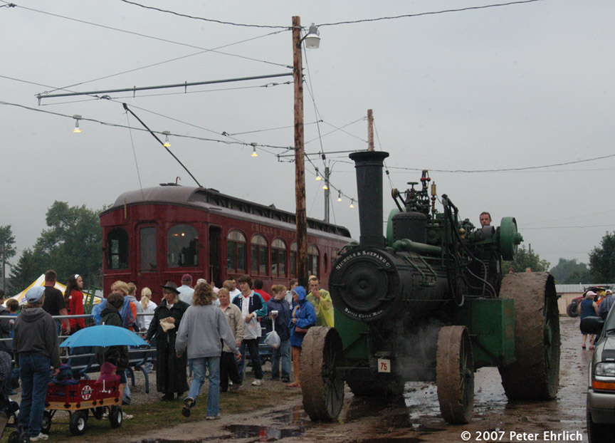 (177k, 864x622)<br><b>Country:</b> United States<br><b>City:</b> Mt. Pleasant, IA<br><b>System:</b> Midwest Old Threshers Museum <br><b>Car:</b>  320 <br><b>Photo by:</b> Peter Ehrlich<br><b>Date:</b> 9/3/2006<br><b>Notes:</b> At the Fairgrounds Streetcar Depot outbound stop, with steam tractors parading in foreground.<br><b>Viewed (this week/total):</b> 1 / 610