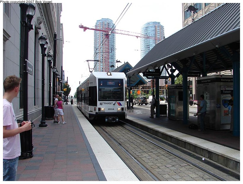 (139k, 820x620)<br><b>Country:</b> United States<br><b>City:</b> Jersey City, NJ<br><b>System:</b> Hudson Bergen Light Rail<br><b>Location:</b> Exchange Place <br><b>Car:</b> NJT-HBLR LRV (Kinki-Sharyo, 1998-99)  2033 <br><b>Photo by:</b> Bob Vogel<br><b>Date:</b> 6/25/2007<br><b>Viewed (this week/total):</b> 0 / 925