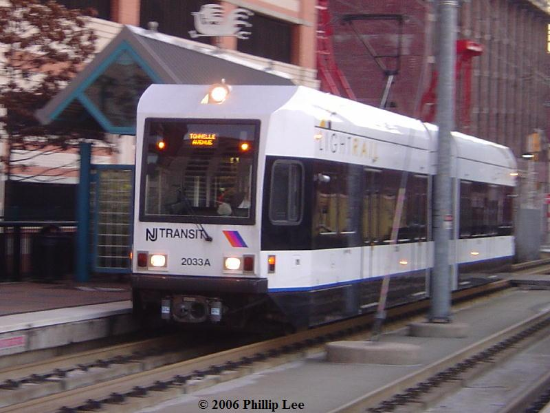 (74k, 800x600)<br><b>Country:</b> United States<br><b>City:</b> Jersey City, NJ<br><b>System:</b> Hudson Bergen Light Rail<br><b>Location:</b> Harsimus Cove <br><b>Car:</b> NJT-HBLR LRV (Kinki-Sharyo, 1998-99)  2033 <br><b>Photo by:</b> Phillip Lee<br><b>Date:</b> 12/23/2006<br><b>Viewed (this week/total):</b> 0 / 695