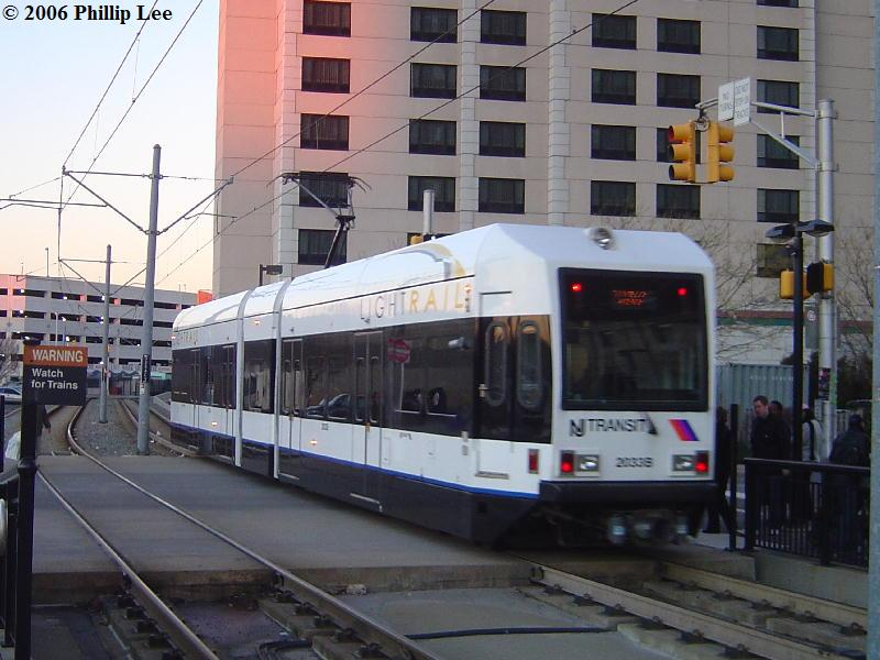 (85k, 800x600)<br><b>Country:</b> United States<br><b>City:</b> Jersey City, NJ<br><b>System:</b> Hudson Bergen Light Rail<br><b>Location:</b> Harsimus Cove <br><b>Car:</b> NJT-HBLR LRV (Kinki-Sharyo, 1998-99)  2033 <br><b>Photo by:</b> Phillip Lee<br><b>Date:</b> 12/23/2006<br><b>Viewed (this week/total):</b> 1 / 704