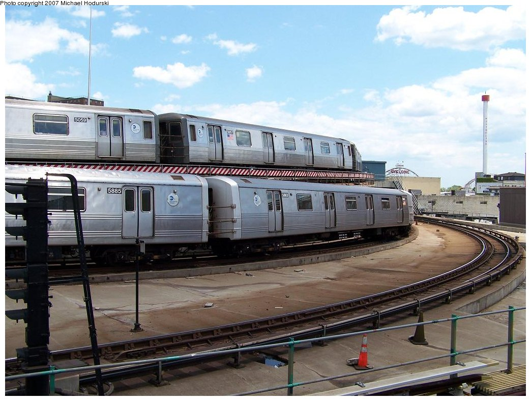 (190k, 1044x788)<br><b>Country:</b> United States<br><b>City:</b> New York<br><b>System:</b> New York City Transit<br><b>Location:</b> Coney Island/Stillwell Avenue<br><b>Route:</b> F<br><b>Car:</b> R-46 (Pullman-Standard, 1974-75) 5883 <br><b>Photo by:</b> Michael Hodurski<br><b>Date:</b> 6/22/2007<br><b>Notes:</b> With R68A 5087 on Q.<br><b>Viewed (this week/total):</b> 2 / 3028