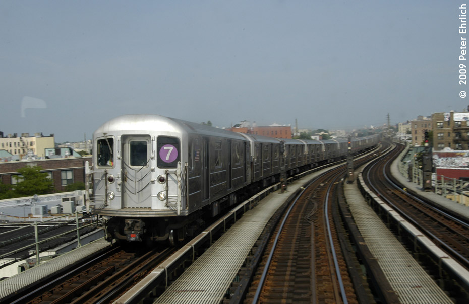 (166k, 930x604)<br><b>Country:</b> United States<br><b>City:</b> New York<br><b>System:</b> New York City Transit<br><b>Line:</b> IRT Flushing Line<br><b>Location:</b> 61st Street/Woodside <br><b>Route:</b> 7<br><b>Car:</b> R-62A (Bombardier, 1984-1987)  1730 <br><b>Photo by:</b> Peter Ehrlich<br><b>Date:</b> 7/22/2009<br><b>Notes:</b> West of 61st Street, inbound<br><b>Viewed (this week/total):</b> 0 / 491