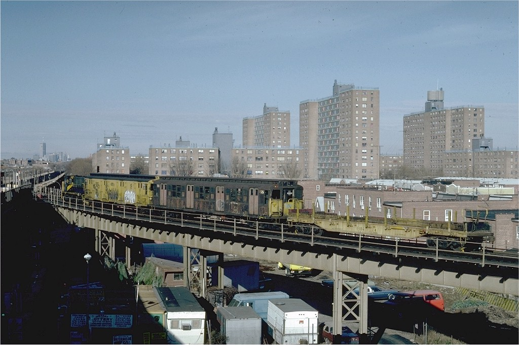 (194k, 1024x680)<br><b>Country:</b> United States<br><b>City:</b> New York<br><b>System:</b> New York City Transit<br><b>Line:</b> BMT West End Line<br><b>Location:</b> Bay 50th Street <br><b>Route:</b> Work Service<br><b>Car:</b> Flat Car 184 <br><b>Photo by:</b> Steve Zabel<br><b>Collection of:</b> Joe Testagrose<br><b>Date:</b> 12/10/1981<br><b>Viewed (this week/total):</b> 5 / 2997