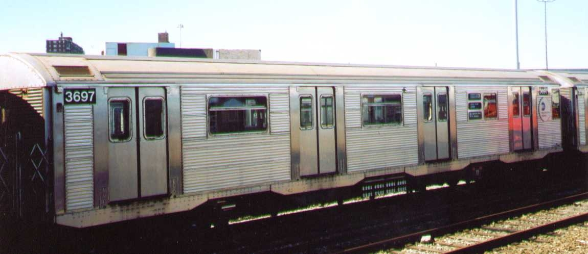 (137k, 1150x498)<br><b>Country:</b> United States<br><b>City:</b> New York<br><b>System:</b> New York City Transit<br><b>Location:</b> Coney Island Yard<br><b>Car:</b> R-32 (Budd, 1964)  3697 <br><b>Photo by:</b> Bob Wright<br><b>Date:</b> 9/22/2002<br><b>Viewed (this week/total):</b> 1 / 1561
