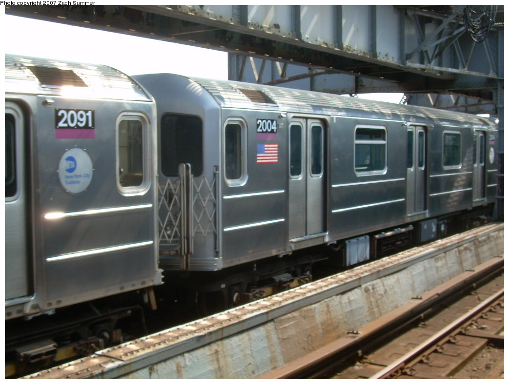 (183k, 1044x788)<br><b>Country:</b> United States<br><b>City:</b> New York<br><b>System:</b> New York City Transit<br><b>Line:</b> IRT Flushing Line<br><b>Location:</b> 111th Street <br><b>Route:</b> 7<br><b>Car:</b> R-62A (Bombardier, 1984-1987)  2004 <br><b>Photo by:</b> Zach Summer<br><b>Date:</b> 6/18/2007<br><b>Viewed (this week/total):</b> 1 / 1773