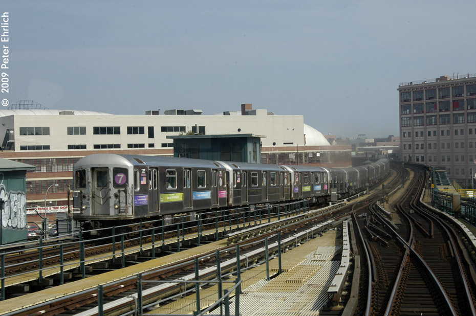 (199k, 930x618)<br><b>Country:</b> United States<br><b>City:</b> New York<br><b>System:</b> New York City Transit<br><b>Line:</b> IRT Flushing Line<br><b>Location:</b> 33rd Street/Rawson Street <br><b>Route:</b> 7<br><b>Car:</b> R-62A (Bombardier, 1984-1987)  1765 <br><b>Photo by:</b> Peter Ehrlich<br><b>Date:</b> 7/22/2009<br><b>Notes:</b> Inbound train having just left 33rd/Rawson<br><b>Viewed (this week/total):</b> 0 / 660