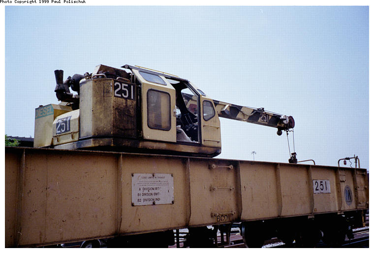 (61k, 760x514)<br><b>Country:</b> United States<br><b>City:</b> New York<br><b>System:</b> New York City Transit<br><b>Location:</b> Corona Yard<br><b>Car:</b> Crane Car 251 <br><b>Photo by:</b> Paul Polischuk<br><b>Date:</b> 6/25/1999<br><b>Viewed (this week/total):</b> 0 / 3933