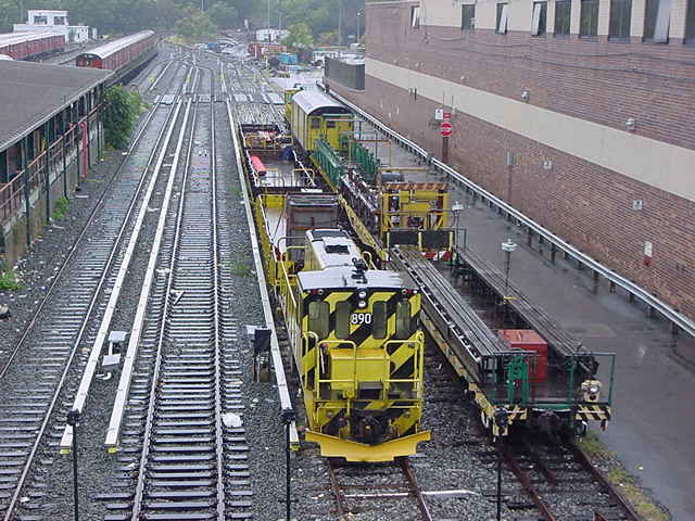 (60k, 640x480)<br><b>Country:</b> United States<br><b>City:</b> New York<br><b>System:</b> New York City Transit<br><b>Location:</b> Corona Yard<br><b>Car:</b> R-77 Locomotive  890 <br><b>Photo by:</b> Salaam Allah<br><b>Date:</b> 9/26/2002<br><b>Viewed (this week/total):</b> 4 / 2733
