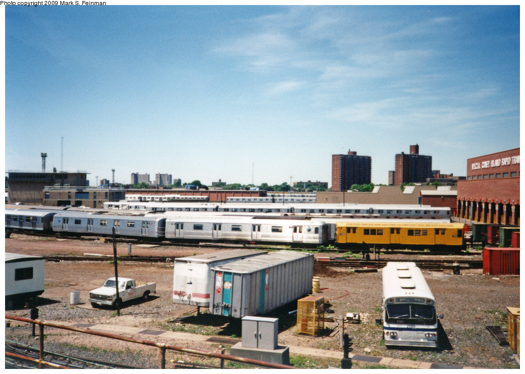 (255k, 1044x743)<br><b>Country:</b> United States<br><b>City:</b> New York<br><b>System:</b> New York City Transit<br><b>Location:</b> Coney Island Yard<br><b>Photo by:</b> Mark S. Feinman<br><b>Date:</b> 5/30/1993<br><b>Notes:</b> View from Avenue X. Visible are an R21 in work service and an old Flxible bus.<br><b>Viewed (this week/total):</b> 1 / 2574