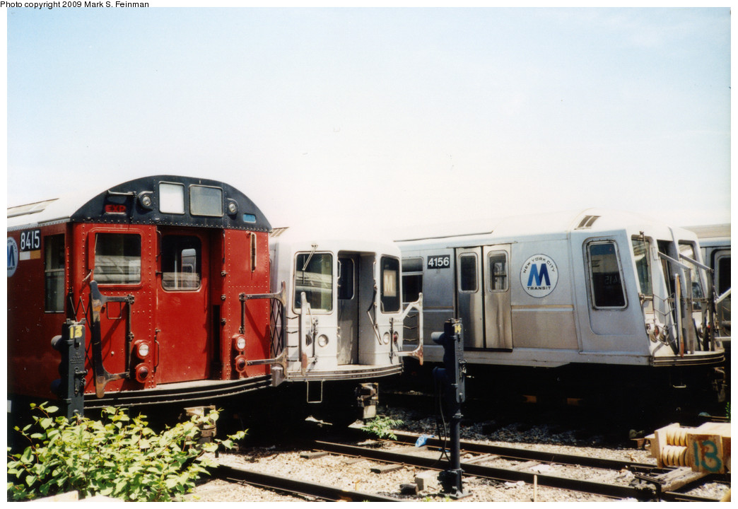(207k, 1044x720)<br><b>Country:</b> United States<br><b>City:</b> New York<br><b>System:</b> New York City Transit<br><b>Location:</b> Coney Island Yard<br><b>Photo by:</b> Mark S. Feinman<br><b>Date:</b> 5/30/1993<br><b>Notes:</b> On yard loop track. Three models of NYC subway car visible: R30 #8415, R42, R40 #4156<br><b>Viewed (this week/total):</b> 1 / 2646