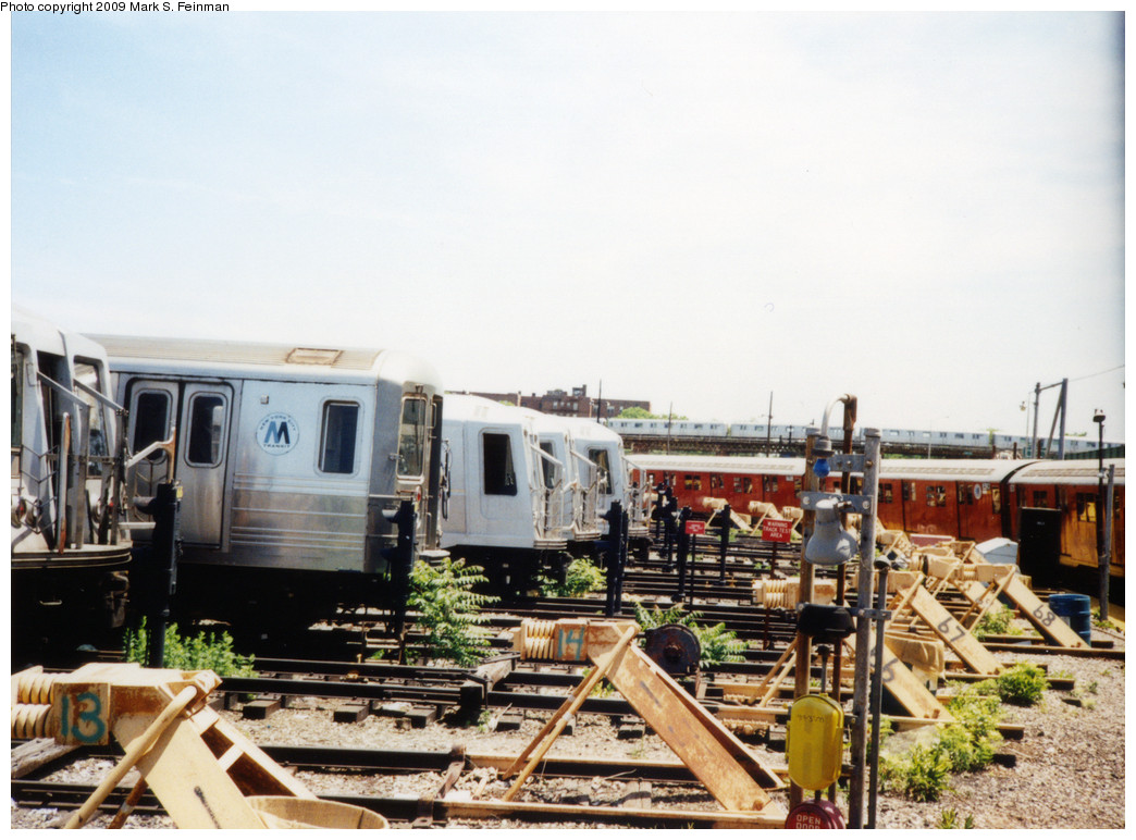 (244k, 1044x772)<br><b>Country:</b> United States<br><b>City:</b> New York<br><b>System:</b> New York City Transit<br><b>Location:</b> Coney Island Yard<br><b>Photo by:</b> Mark S. Feinman<br><b>Date:</b> 5/30/1993<br><b>Notes:</b> An R68 and refurbished R40s, and a train of R46 cars can be seen on the Culver Line viaduct in the distance<br><b>Viewed (this week/total):</b> 1 / 2238