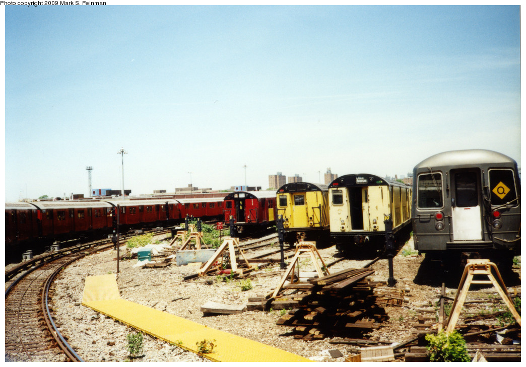 (250k, 1044x729)<br><b>Country:</b> United States<br><b>City:</b> New York<br><b>System:</b> New York City Transit<br><b>Location:</b> Coney Island Yard<br><b>Photo by:</b> Mark S. Feinman<br><b>Date:</b> 5/30/1993<br><b>Notes:</b> Visible are an R30, two R21s, and an R68, and the fan trip train looping thru the yard<br><b>Viewed (this week/total):</b> 2 / 2698