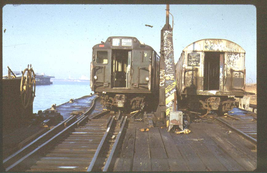(81k, 867x561)<br><b>Country:</b> United States<br><b>City:</b> New York<br><b>System:</b> New York City Transit<br><b>Location:</b> Scrapyard<br><b>Photo by:</b> Harold<br><b>Notes:</b> R10 and R27/30 at NYCH car float<br><b>Viewed (this week/total):</b> 2 / 8784