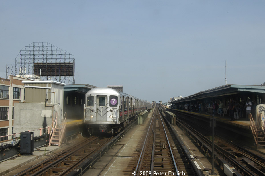 (152k, 930x618)<br><b>Country:</b> United States<br><b>City:</b> New York<br><b>System:</b> New York City Transit<br><b>Line:</b> IRT Flushing Line<br><b>Location:</b> 33rd Street/Rawson Street <br><b>Route:</b> 7<br><b>Car:</b> R-62A (Bombardier, 1984-1987)  1785 <br><b>Photo by:</b> Peter Ehrlich<br><b>Date:</b> 7/22/2009<br><b>Notes:</b> Inbound; another inbound train is visible at 40th Street.<br><b>Viewed (this week/total):</b> 4 / 458