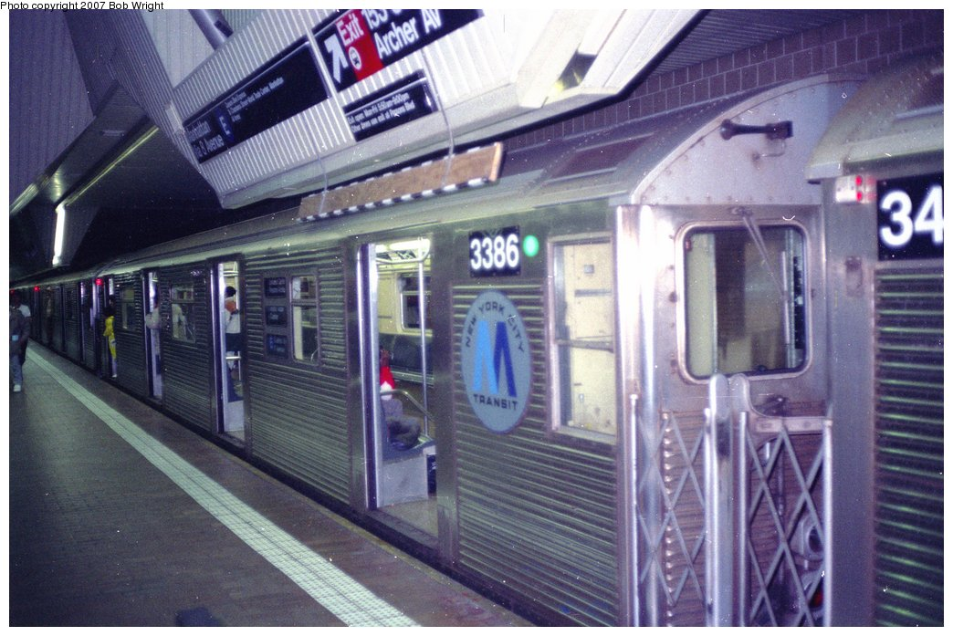 (161k, 1044x697)<br><b>Country:</b> United States<br><b>City:</b> New York<br><b>System:</b> New York City Transit<br><b>Line:</b> IND Queens Boulevard Line<br><b>Location:</b> Jamaica Center/Parsons-Archer <br><b>Route:</b> E<br><b>Car:</b> R-32 (Budd, 1964)  3386 <br><b>Photo by:</b> Bob Wright<br><b>Date:</b> 11/10/1991<br><b>Viewed (this week/total):</b> 3 / 3588
