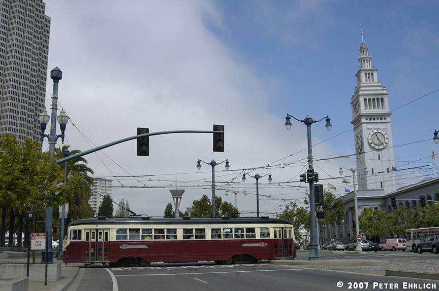 (158k, 864x574)<br><b>Country:</b> United States<br><b>City:</b> San Francisco/Bay Area, CA<br><b>System:</b> SF MUNI<br><b>Location:</b> Embarcadero/Don Chee Way <br><b>Car:</b> SF MUNI PCC Torpedo Double-End (St. Louis Car Co., 1948)  1007 <br><b>Photo by:</b> Peter Ehrlich<br><b>Date:</b> 7/26/2007<br><b>Notes:</b> Ferry Plaza (Embarcadero/Don Chee Way) inbound, side view.<br><b>Viewed (this week/total):</b> 0 / 635