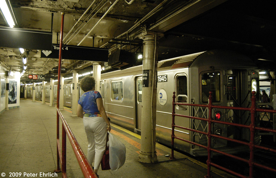 (221k, 930x601)<br><b>Country:</b> United States<br><b>City:</b> New York<br><b>System:</b> New York City Transit<br><b>Line:</b> IRT Times Square-Grand Central Shuttle<br><b>Location:</b> Times Square <br><b>Car:</b> R-62A (Bombardier, 1984-1987)  1945 <br><b>Photo by:</b> Peter Ehrlich<br><b>Date:</b> 7/22/2009<br><b>Viewed (this week/total):</b> 0 / 817