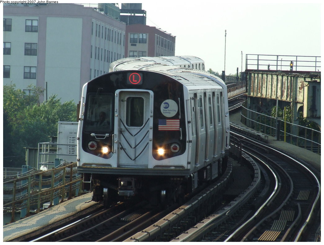 (176k, 1044x788)<br><b>Country:</b> United States<br><b>City:</b> New York<br><b>System:</b> New York City Transit<br><b>Line:</b> BMT Canarsie Line<br><b>Location:</b> Sutter Avenue <br><b>Route:</b> L<br><b>Car:</b> R-143 (Kawasaki, 2001-2002) 8113 <br><b>Photo by:</b> John Barnes<br><b>Date:</b> 8/2/2007<br><b>Viewed (this week/total):</b> 2 / 2032