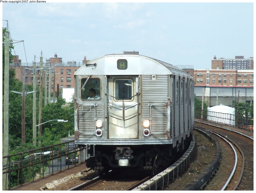 (186k, 1044x788)<br><b>Country:</b> United States<br><b>City:</b> New York<br><b>System:</b> New York City Transit<br><b>Line:</b> IND Rockaway<br><b>Location:</b> Beach 67th Street/Gaston Avenue <br><b>Route:</b> A<br><b>Car:</b> R-32 (Budd, 1964)  3553 <br><b>Photo by:</b> John Barnes<br><b>Date:</b> 7/22/2007<br><b>Viewed (this week/total):</b> 3 / 2084