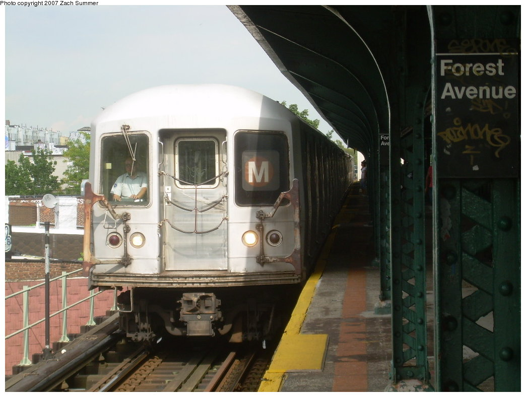 (185k, 1044x788)<br><b>Country:</b> United States<br><b>City:</b> New York<br><b>System:</b> New York City Transit<br><b>Line:</b> BMT Myrtle Avenue Line<br><b>Location:</b> Forest Avenue <br><b>Route:</b> M<br><b>Car:</b> R-42 (St. Louis, 1969-1970)  4904 <br><b>Photo by:</b> Zach Summer<br><b>Date:</b> 8/28/2007<br><b>Viewed (this week/total):</b> 1 / 1818