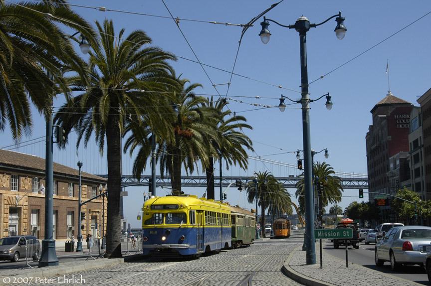 (217k, 864x574)<br><b>Country:</b> United States<br><b>City:</b> San Francisco/Bay Area, CA<br><b>System:</b> SF MUNI<br><b>Location:</b> Embarcadero/Ferry Plaza Layover <br><b>Car:</b> SF MUNI PCC Torpedo Double-End (St. Louis Car Co., 1948)  1010 <br><b>Photo by:</b> Peter Ehrlich<br><b>Date:</b> 8/22/2007<br><b>Notes:</b> Ferries layover.  With 496 (Melbourne), and 1859 (Milan) across Mission Street.<br><b>Viewed (this week/total):</b> 0 / 527