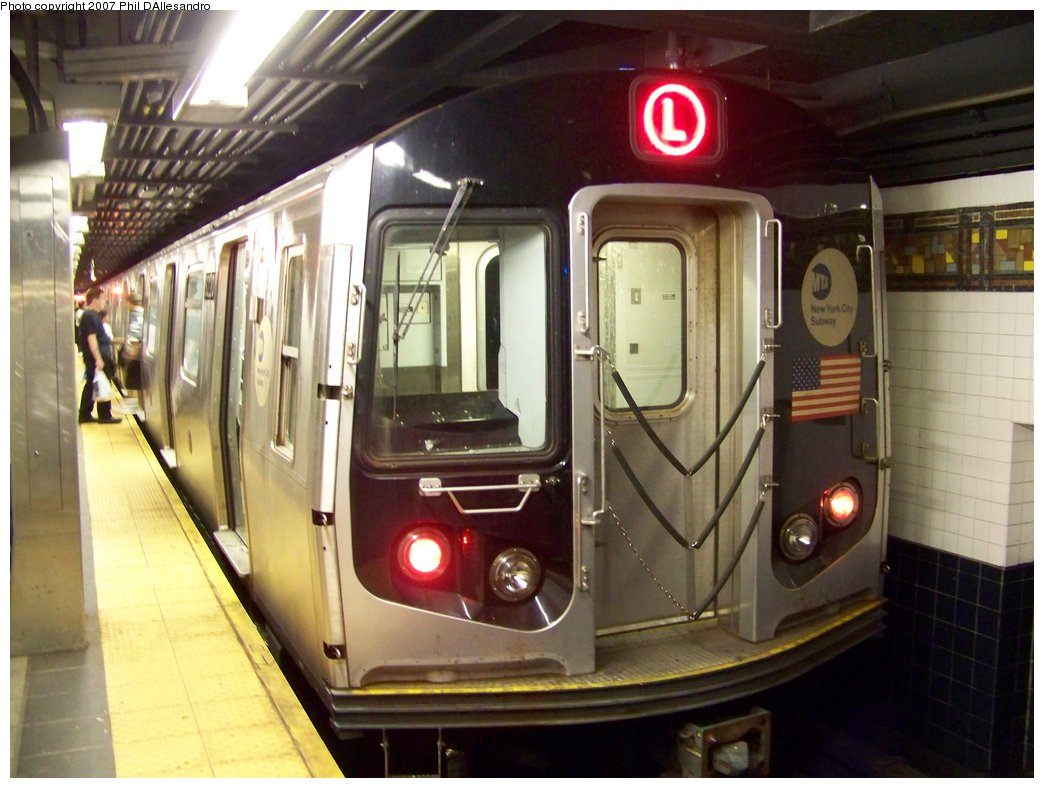 (167k, 1044x788)<br><b>Country:</b> United States<br><b>City:</b> New York<br><b>System:</b> New York City Transit<br><b>Line:</b> BMT Myrtle Avenue Line<br><b>Location:</b> Wyckoff Avenue <br><b>Route:</b> L<br><b>Car:</b> R-143 (Kawasaki, 2001-2002) 8220 <br><b>Photo by:</b> Philip D'Allesandro<br><b>Date:</b> 9/13/2007<br><b>Viewed (this week/total):</b> 0 / 1346