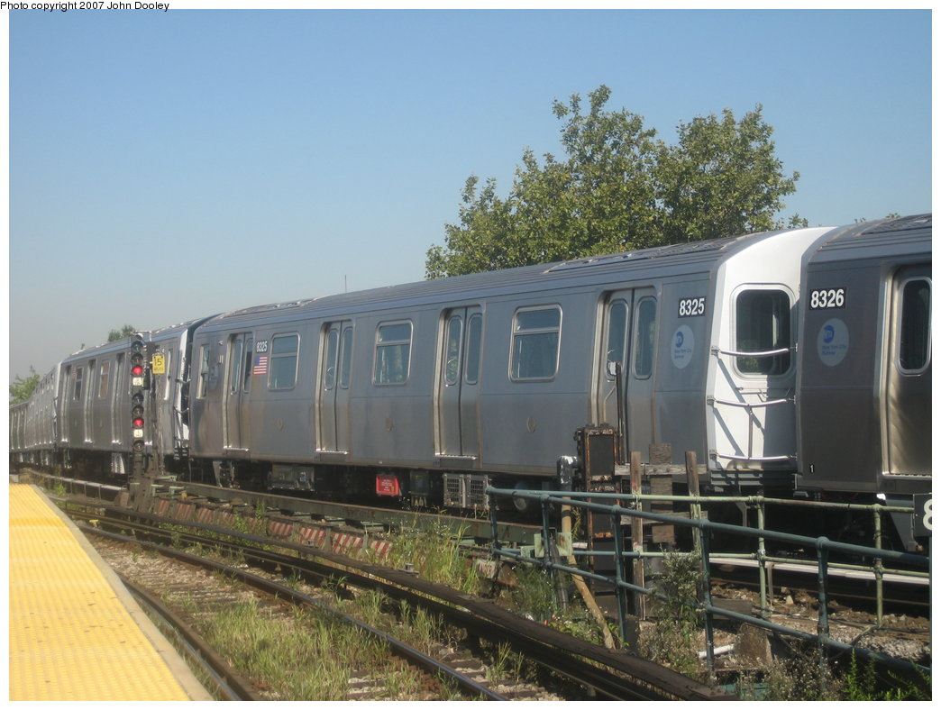 (173k, 1044x788)<br><b>Country:</b> United States<br><b>City:</b> New York<br><b>System:</b> New York City Transit<br><b>Line:</b> BMT Nassau Street/Jamaica Line<br><b>Location:</b> Broadway/East New York (Broadway Junction) <br><b>Route:</b> Z<br><b>Car:</b> R-160A-1 (Alstom, 2005-2008, 4 car sets)  8325 <br><b>Photo by:</b> John Dooley<br><b>Date:</b> 9/20/2007<br><b>Viewed (this week/total):</b> 4 / 1710