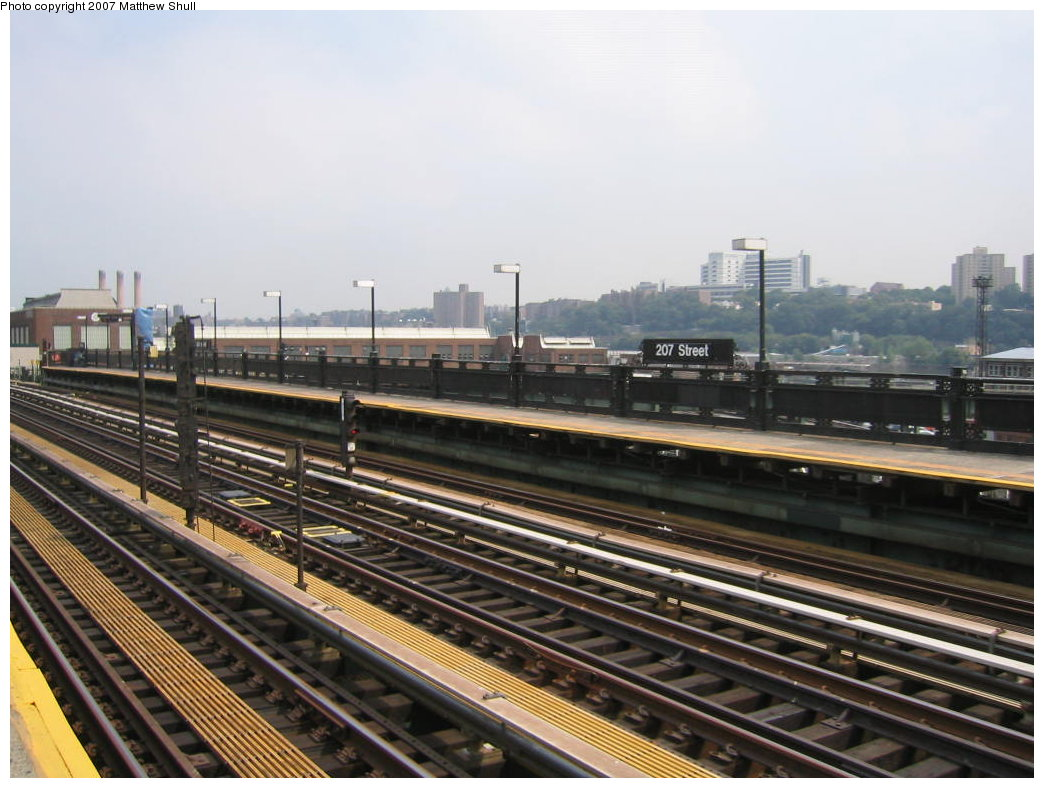(169k, 1044x788)<br><b>Country:</b> United States<br><b>City:</b> New York<br><b>System:</b> New York City Transit<br><b>Line:</b> IRT West Side Line<br><b>Location:</b> 207th Street <br><b>Photo by:</b> Matthew Shull<br><b>Date:</b> 8/30/2007<br><b>Notes:</b> View of Bronx-bound platform with 207th St Yard & Shops in background<br><b>Viewed (this week/total):</b> 0 / 1044
