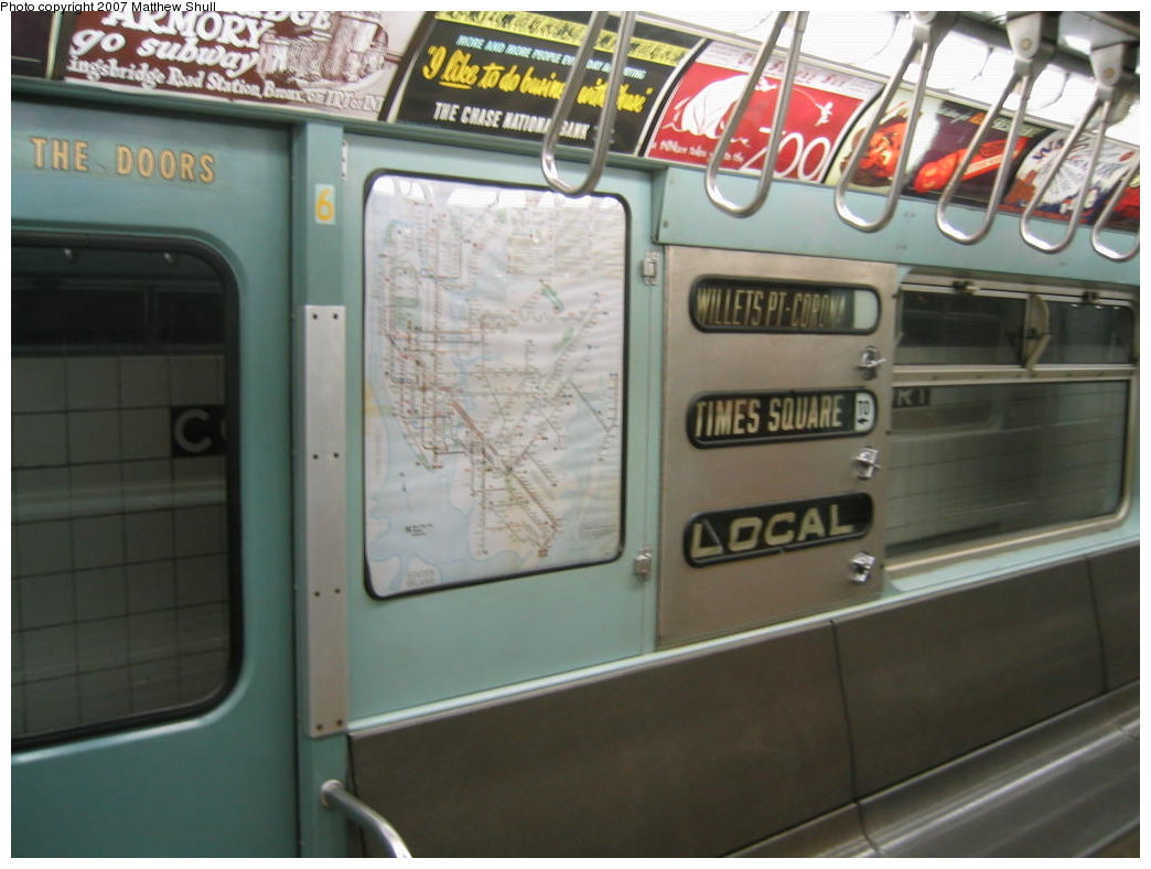 (143k, 1044x788)<br><b>Country:</b> United States<br><b>City:</b> New York<br><b>System:</b> New York City Transit<br><b>Location:</b> New York Transit Museum<br><b>Car:</b> R-33 World's Fair (St. Louis, 1963-64) 9306 <br><b>Photo by:</b> Matthew Shull<br><b>Date:</b> 8/31/2007<br><b>Notes:</b> Interior Rollsigns - Properly set for 7 route to Willets Point<br><b>Viewed (this week/total):</b> 3 / 2205