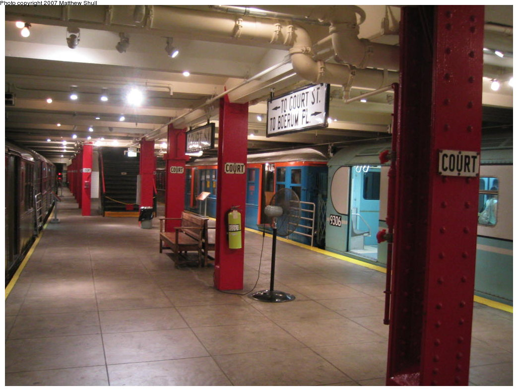 (151k, 1044x788)<br><b>Country:</b> United States<br><b>City:</b> New York<br><b>System:</b> New York City Transit<br><b>Location:</b> New York Transit Museum<br><b>Photo by:</b> Matthew Shull<br><b>Date:</b> 8/31/2007<br><b>Notes:</b> Platform View of World's Fair Cars - BMT Q 1612 & R33 WF 9306 - Also Closed Exit to Court St<br><b>Viewed (this week/total):</b> 3 / 3166