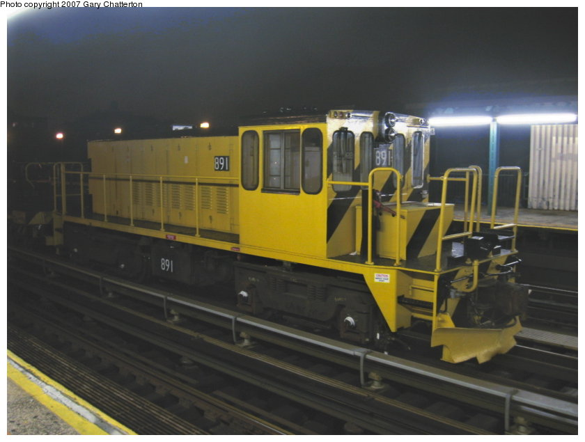 (84k, 840x635)<br><b>Country:</b> United States<br><b>City:</b> New York<br><b>System:</b> New York City Transit<br><b>Line:</b> IRT Flushing Line<br><b>Location:</b> 69th Street/Fisk Avenue <br><b>Route:</b> Work Service<br><b>Car:</b> R-77 Locomotive  891 <br><b>Photo by:</b> Gary Chatterton<br><b>Date:</b> 9/23/2007<br><b>Viewed (this week/total):</b> 4 / 657